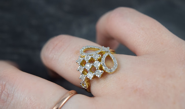 Gold Diamond Ring on Finger