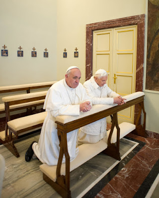 Two popes praying