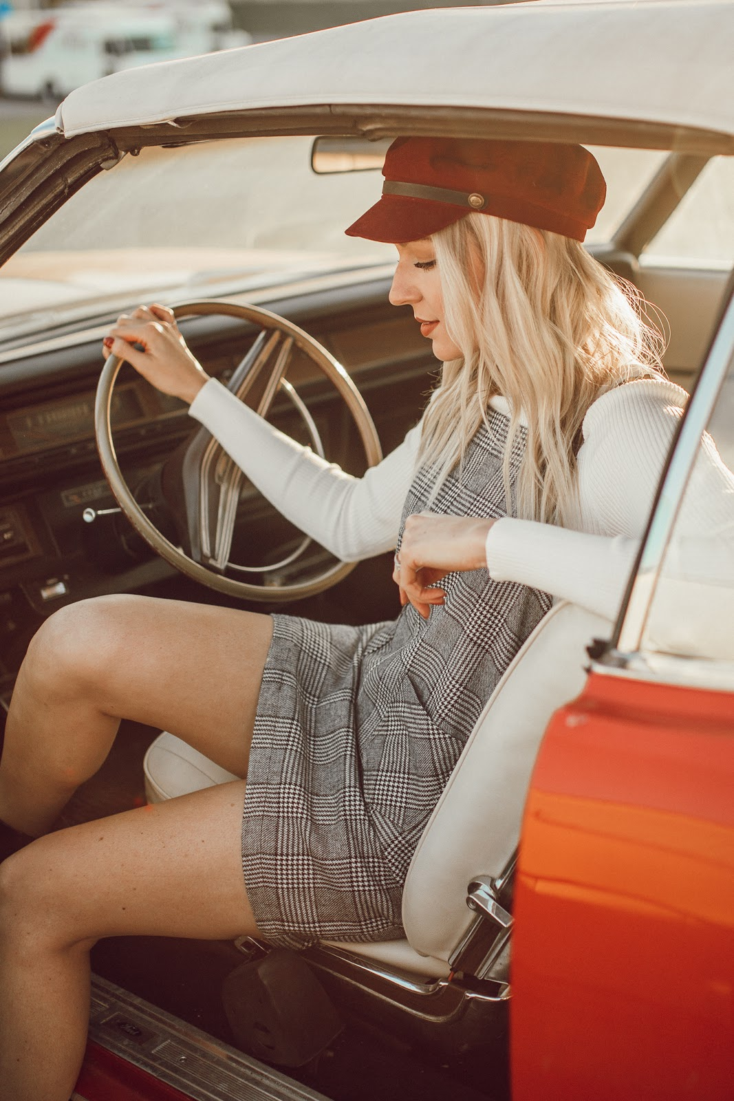 plaid dress in a vintage car