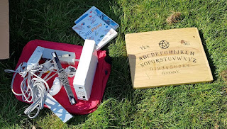 A Nintendo Wii games console and a Ouija Board at a Car Boot Sale in Ipswich