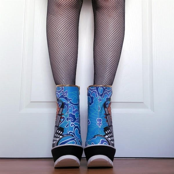front view of blue patterned ankle boots on legs wearing fishnet tights