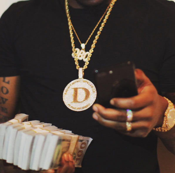 Davido flaunts wads of cash, private jet, exotic cars