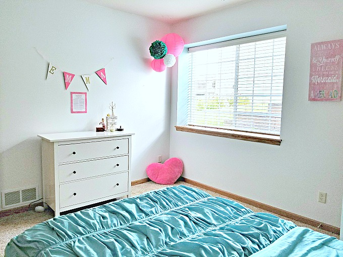 This guest room became a cute pink and teal tween bedroom!
