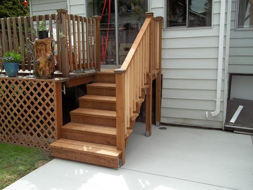 Three guys construction wood steps and railing broom for Concrete patio railing