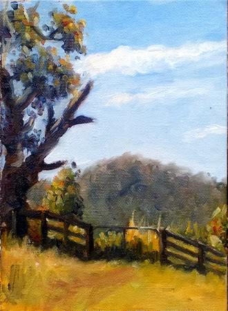 Oil painting of a snow gum beside a gate in a post-rail fence, with a tree-covered hill in the distance and dry grass in the foreground.