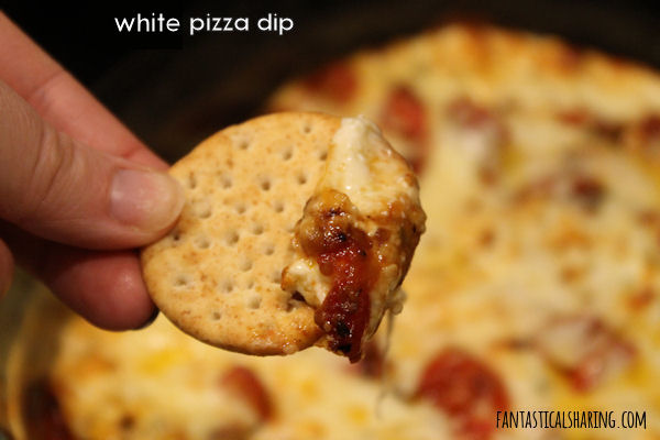 White Pizza Dip // Pizza gets a gourmet upgrade and is made into the perfect appetizer with roasted tomatoes and fresh herbs! #recipe #appetizer #cheese #tomatoes #pizza