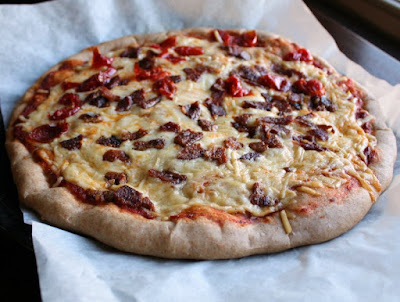 a bacon and red pepper pizza made on whole wheat pizza crust