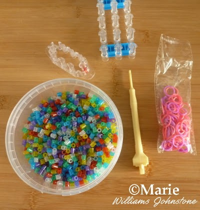 Stretchy rubber bands, loom boards, colorful beads and hook