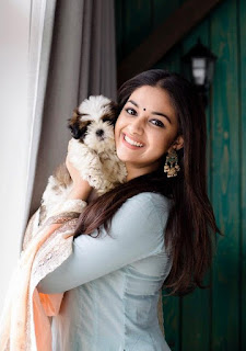 Keerthy Suresh in Blue Dress with Cute and Lovely Smile with a Dog 2