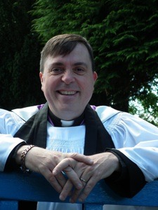 Click the Vicar for Father Warren's info