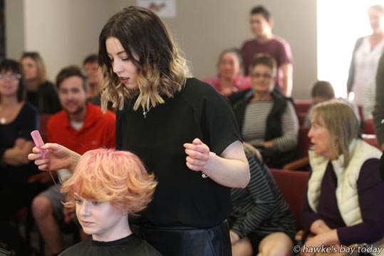 Gracie Nisbet, M>Phosis, working on her model - The Day Style - Live Model, Next Generation Stylist. Hawke's Bay Hairdressing Competition finals at Taradale RSA, Taradale, Napier. photograph