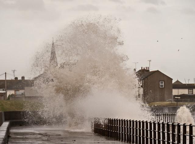 Photo of waves crashing onto  Maryport promenade