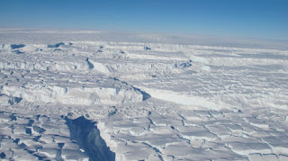 This is a crevassed ice seen on the Thwaites Ice Shelf in October 2012. (Credit: NASA/J. Yungel) Click to Enlarge.