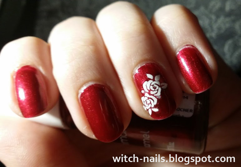 red nails with white rose stickers