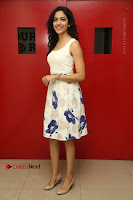 Actress Ritu Varma Stills in White Floral Short Dress at Kesava Movie Success Meet .COM 0021.JPG