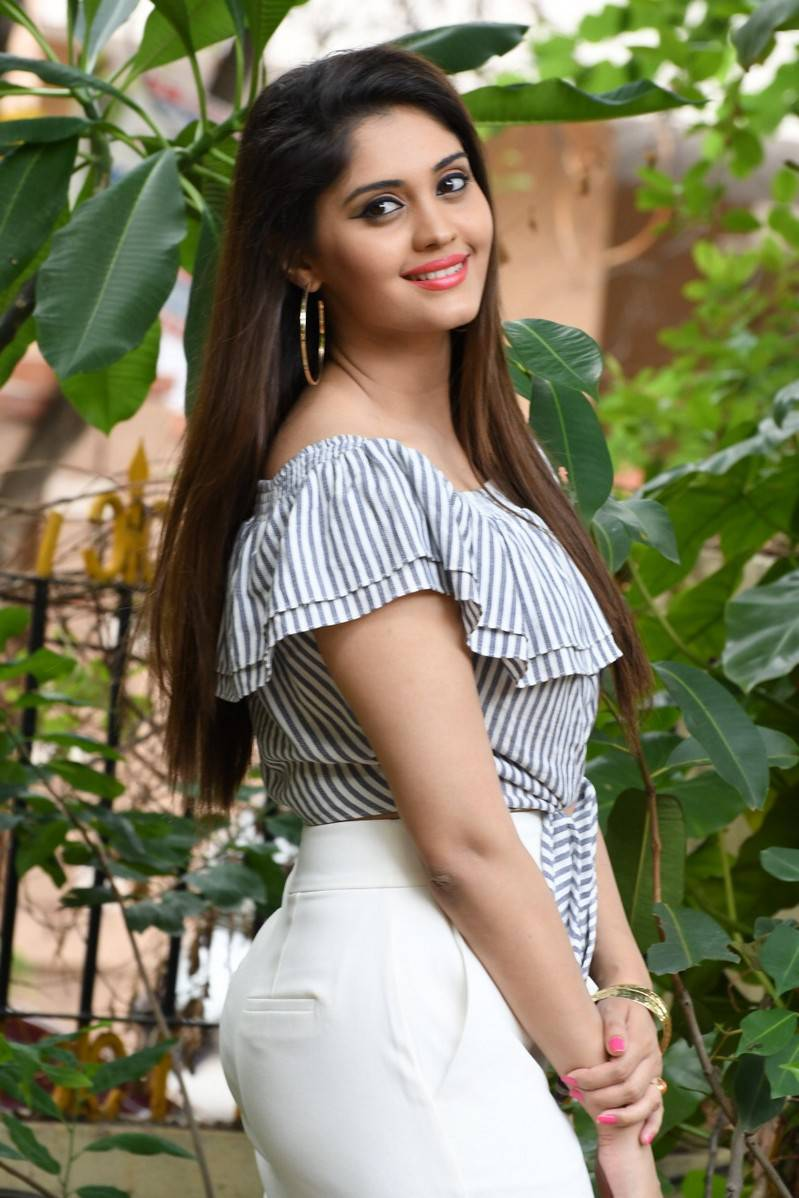 Surabhi Stills Movie Interview In White Top