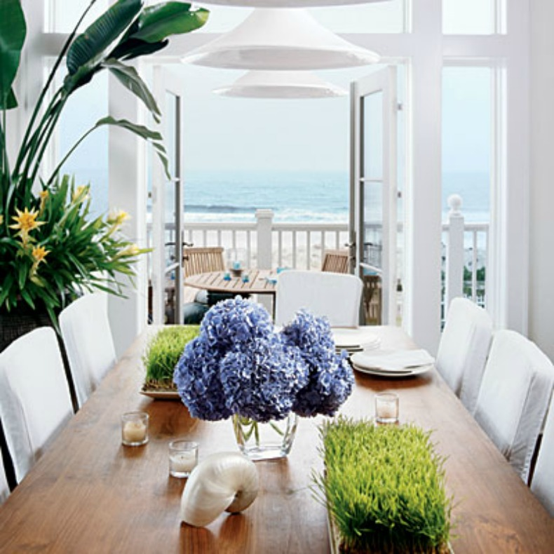 White coastal dining room with an ocean view