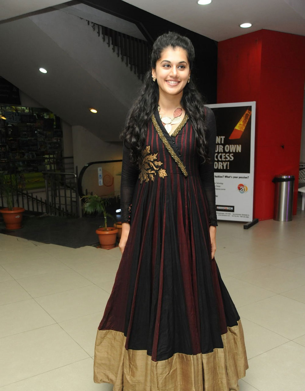 Glamorous Taapsee Pannu Smiling Photos In Maroon Dress