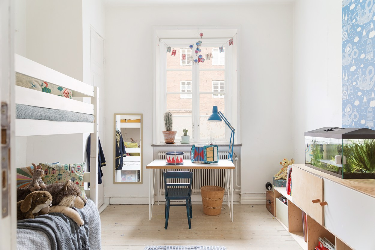 kids room inside of scandinavian aprment,