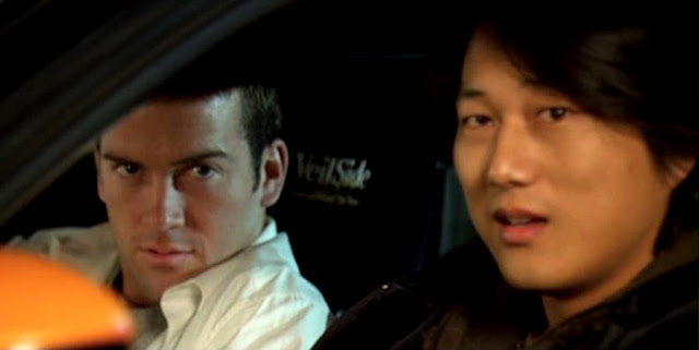 Lucas Black si Sung Kang in Fast & Furious: Tokyo Drift
