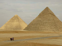 A lone horse and carriage at the pyramids in Giza.