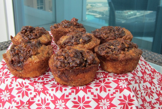 Food Lust People Love: Banana muffins filled and topped with a bananas Foster sauce of brown sugar, rum and pecans! These Bananas Foster Muffins are a decadent breakfast or a handheld dessert!