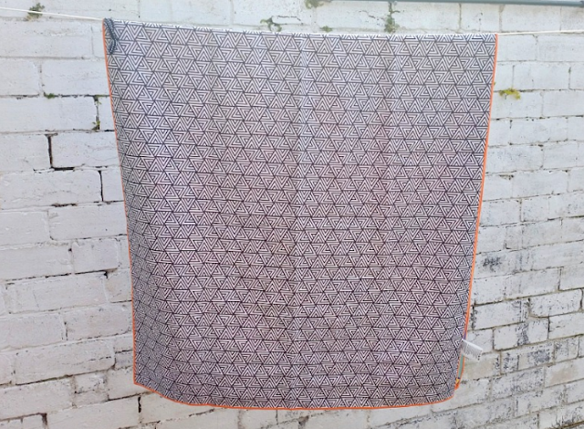 the underside of the tesalate towel. A black and white checked design.