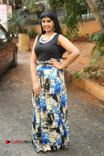 Actress Model Poorni Stills in Floral Long Dress at Silk India Expo Launch  0026.JPG