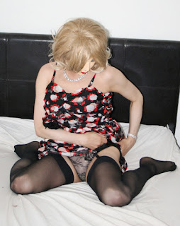 Masked tranny hitches up dress to expose stocking tops