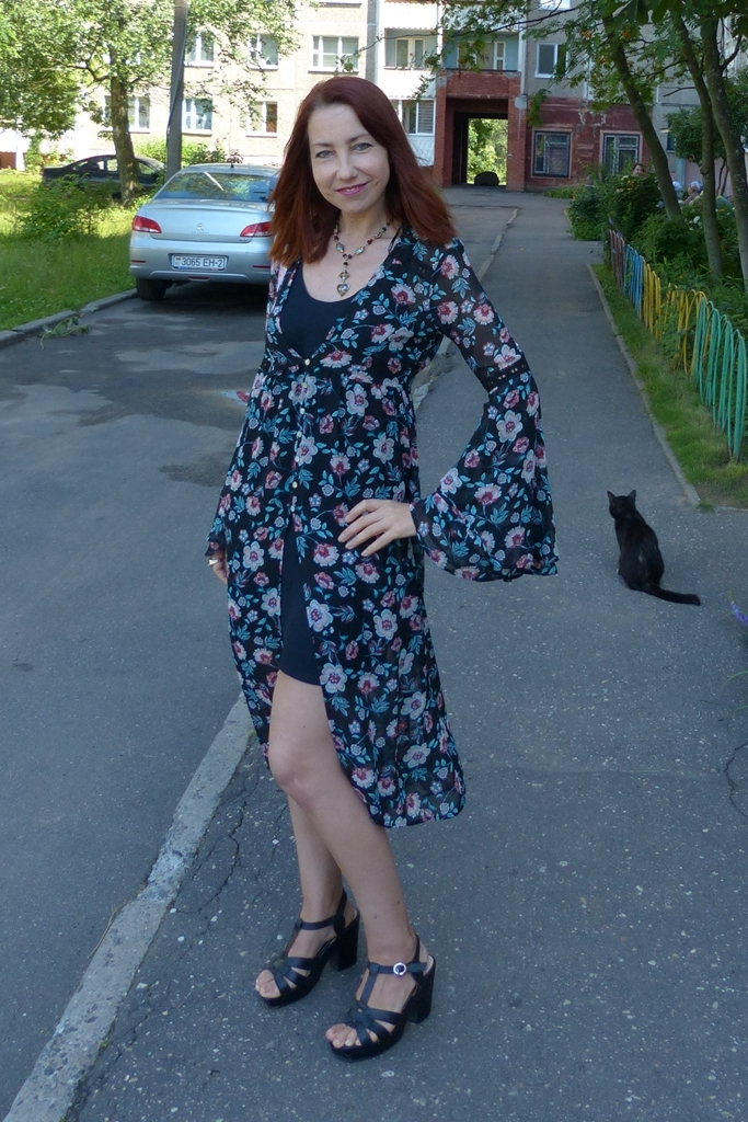 Floral overdress worn with mini dress