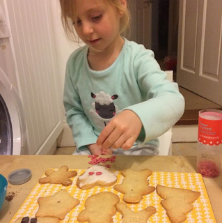 Lily decorating homemade cookies
