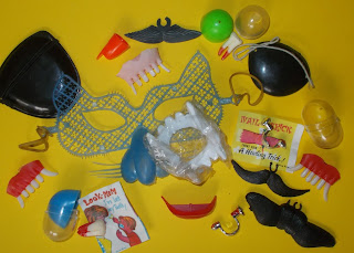 A slesction of Novelty trick body parts and injuies from Christmas crackers, joke shops and gum-ball capsule toy machines including a mask and Fake Novelty Body Parts Fingers Eyes Eye-Patches Mustache Teeth Fangs Bloody Nail Claws
