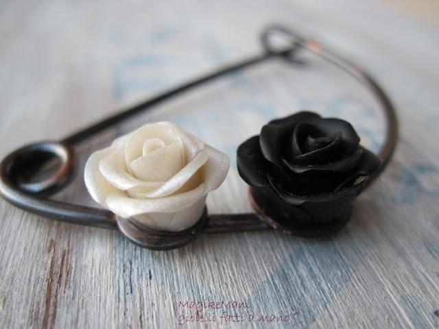 spilla con filo di rame modellato a mano e rose in pasta polimerica