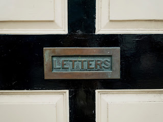 "an old fashioned mailbox that says ""Letters"""