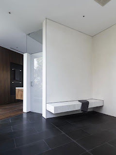 back and white spacious bath room stone touch