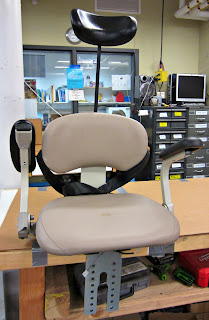 The modified stairlift chair  with an extended headrest.
