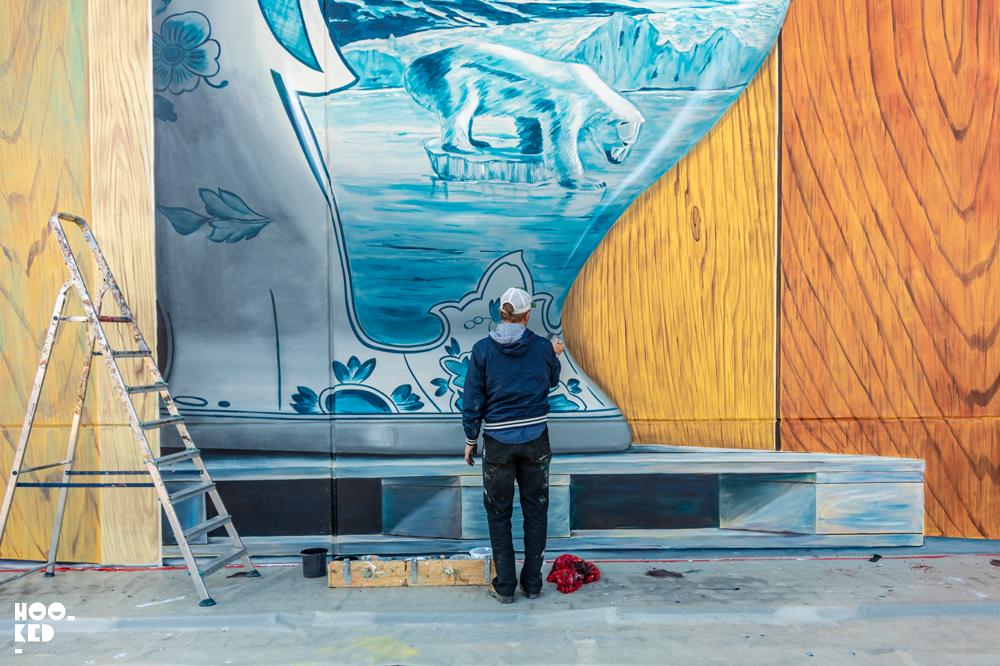 Dutch Artist Leon Keer at work on a 3D street art Mural by  in Ostend, Belgium