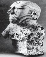 दाढ़ी वाले पुरूष की पत्थर  की मूर्ति