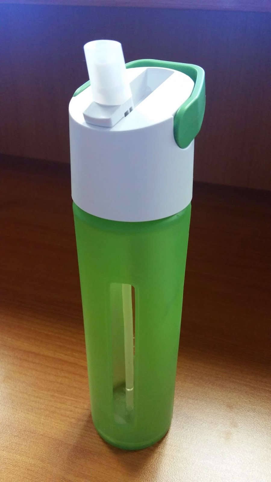 Takeya glass water bottle in green