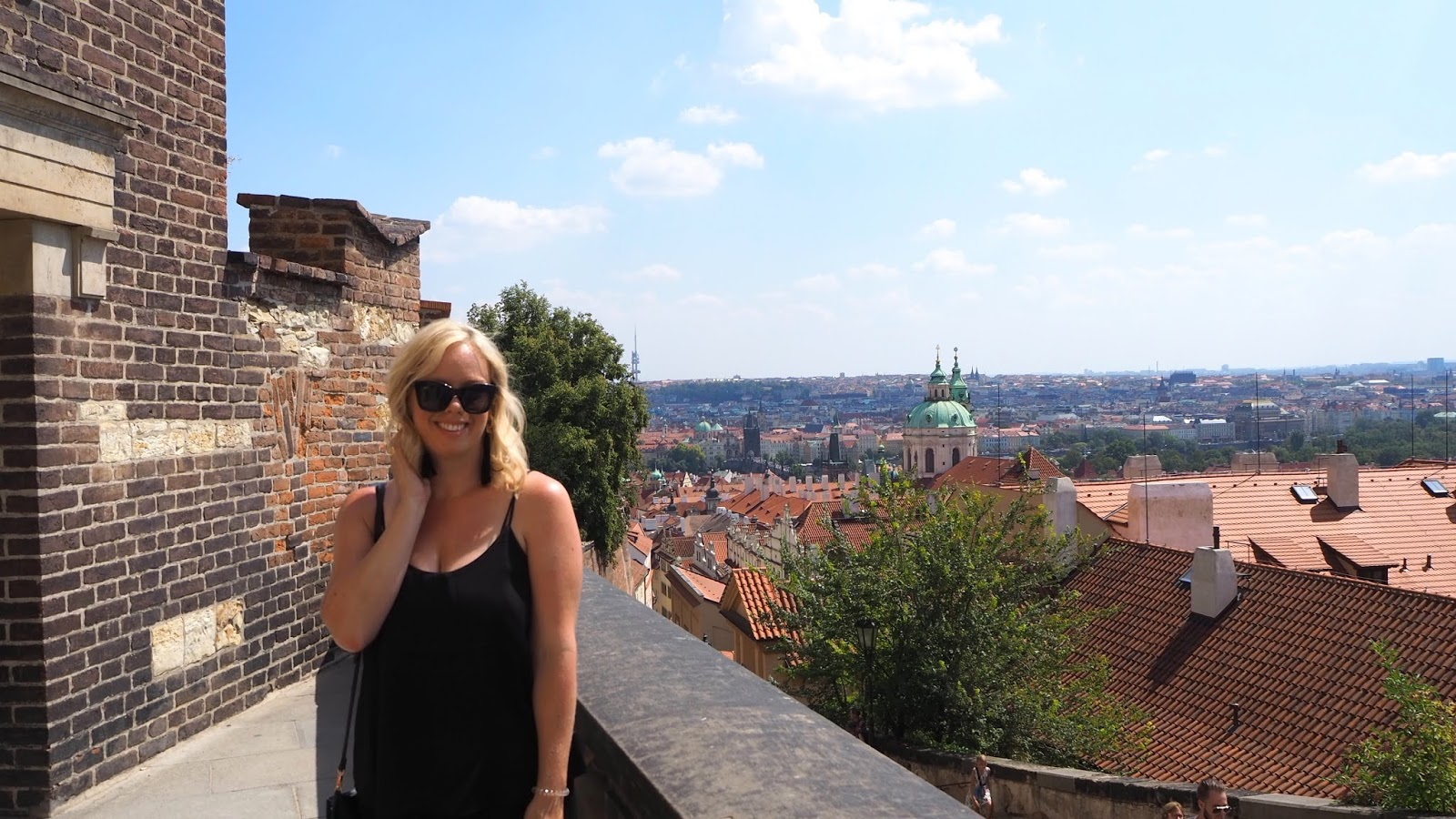 Ashley Turner standing in front of view of Prague from Prague Castle