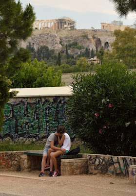 image of couple kissing under the Acropolis