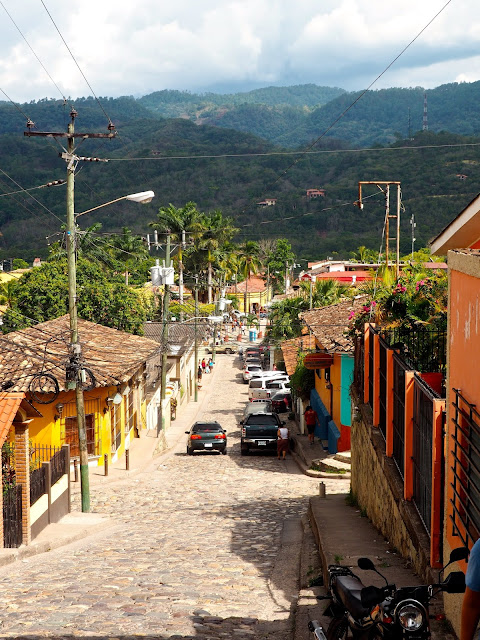 Looking down a cobbled street towards the town square of Copan, Honduras
