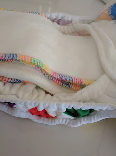 The double gussets pop up to give extra room in the nappy for boosting and a nice leg seal.