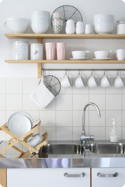 These simple kitchen shelves above the sink are minimal yet functional - the perfect combination