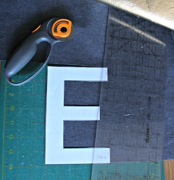 cutting out letters from gold fabric