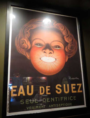 Art deco Eau de Suez dentifrice poster with huge female head and sparkling white teeth