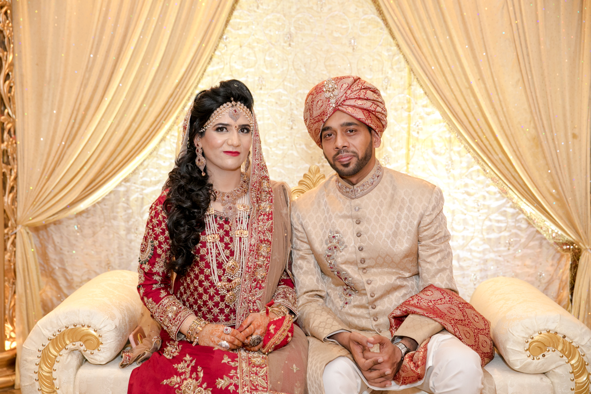 The couple sitting together on the Mandap,a symbol of their unity and unfading love.