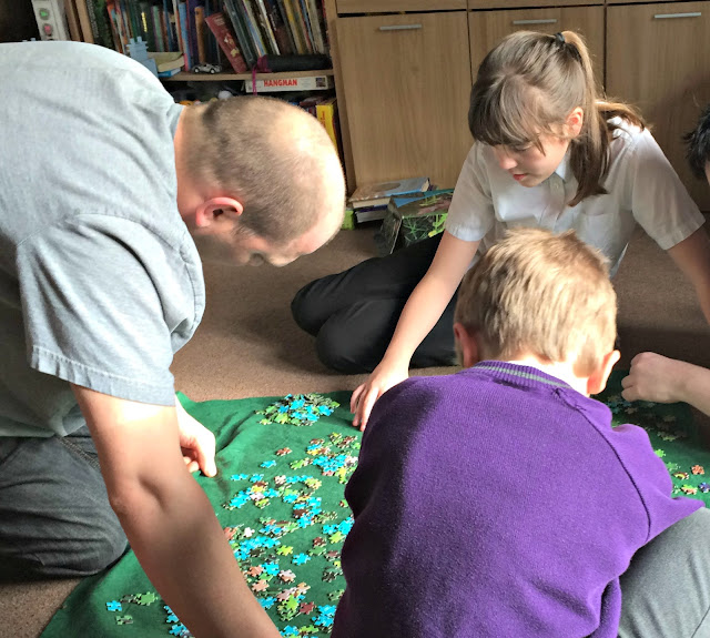 family doing a jigsaw puzzle together