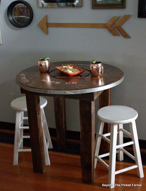 rustic industrial farmhouse round table perfect for coffee or cocktails