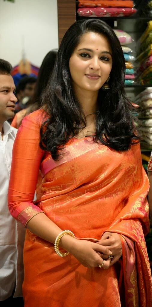 Anushka Shetty Stills In Orange Saree